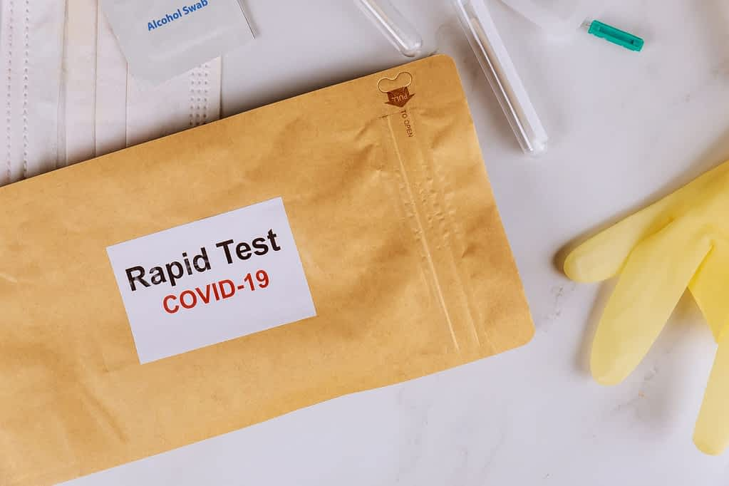 Coronavirus global pandemic rapid test for COVID-19 of a with gloves sterile surgical mask