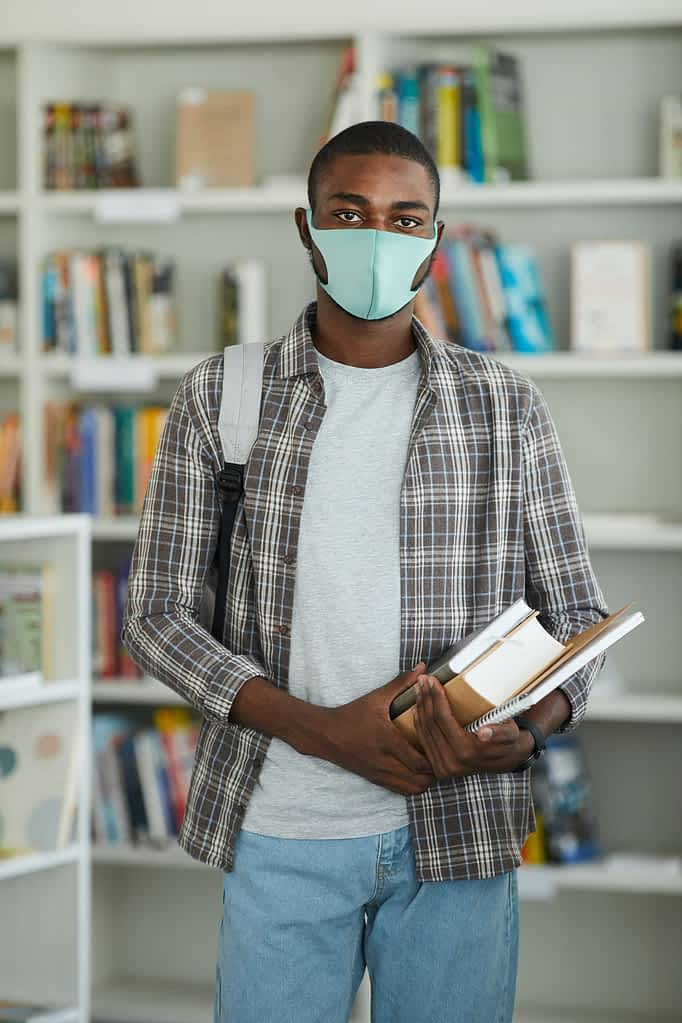 African Student Wearing Mask in Library
